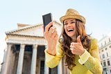 Closeup on happy young woman making selfie and showing thumbs up