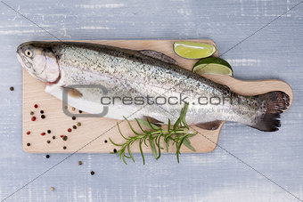 Freh trout on kitchen board.
