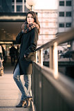 Stylish Pretty Woman Leaning on Pathway Rails