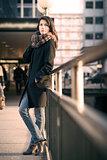 Stylish Pretty Woman Leaning on Pathway Rails