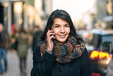 Smiling Woman in Autumn Fashion Talking on Phone