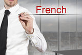 businessman writing french in the air