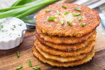 Potato pancakes on a wooden board