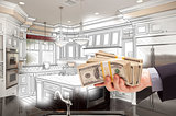 Hand Holding Cash Over Kitchen Design Drawing and Photo Combinat