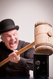 madcap laughs with big hammer on money