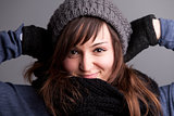 smiling woman posing with hat and warm scarf