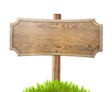 old wood road sign with grass isolated on white