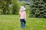 Girl walking on the grass with dandelions