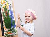 Girl artist paints on canvas