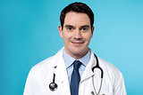 Experienced male doctor posing
