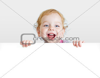 Baby boy showing blank placard with copy space.