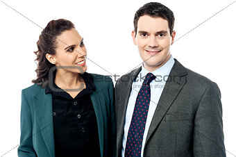 Business couple posing over white