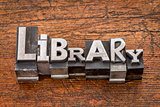 library word in metal type