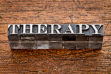 therapy word in metal type