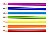 Seven color pencils in arrange in color row on white background