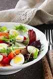 Easter Spring salad with quail eggs, tomatoes and cucumbers