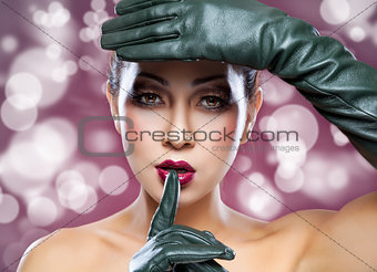 Beautiful Thai woman wearing leather gloves