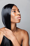 Profile of an young black beauty with straight hair