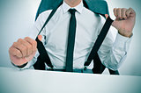 businessman in suspenders in the office