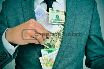 man in suit putting bills in his jacket, depicting concepts such