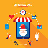 Tablet with Santa Claus on the screen and shopping web icons