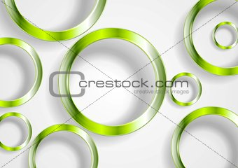 Green shiny circles on white background