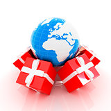 Traditional Christmas gifts and earth. Global holiday concept