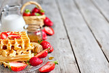Waffles with strawberry abd honey background