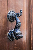 Old doorhandle in the form of an iron fish