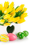 Easter eggs with spring yellow flowers