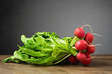 Fresh radishes on wooden table