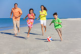 Family Playing Football Soccer on Beach