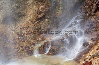 waterfall in rocky Alps