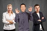 Teamwork and Asian Man Shows OK