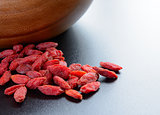 Heap of Dry Goji Berries on the Dark Table