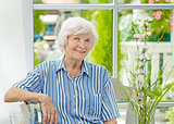 Senior woman sitting at home