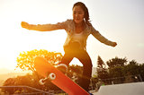 skateboarding woman jumping