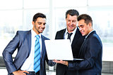 group of business people doing presetation with laptop