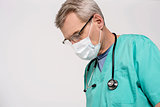 Attentive look of male surgeon