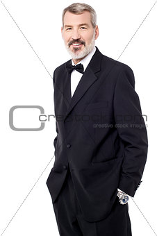 Experienced business posing over white