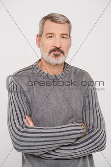 Aged man posing in casuals