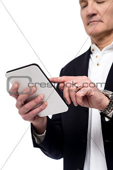 Old man using his tablet pc