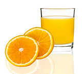 orange juice in a glass with oranges