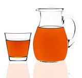 apple juice in a glass and carafe