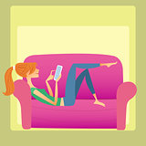 The girl lies on the sofa and reads a smartphone