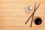Maki sushi, chopsticks and soy sauce