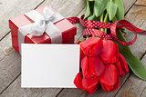 Fresh tulips, gift box and greeting card