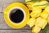 Fresh yellow tulips bouquet and coffee cup