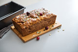 Closeup on freshly baked pumpkin bread with seeds on table