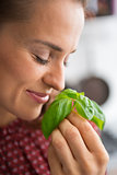 Young woman enjoying fresh basil